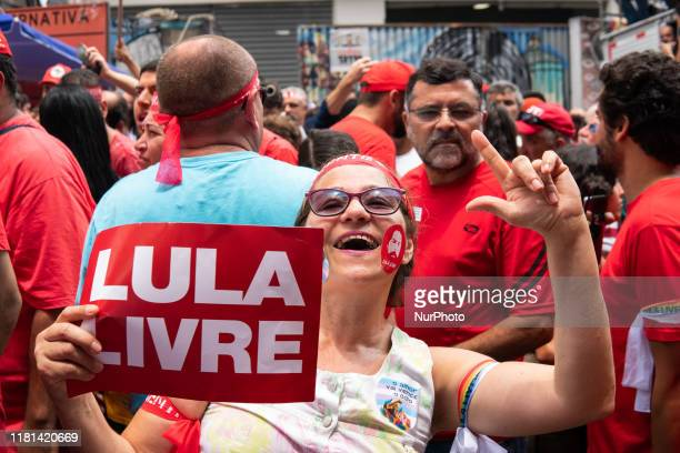 A supporter of former President Luiz Inacio Lula da Silva carries a sign that reads Free Lula in support of his freedom while awaiting his appearance...
