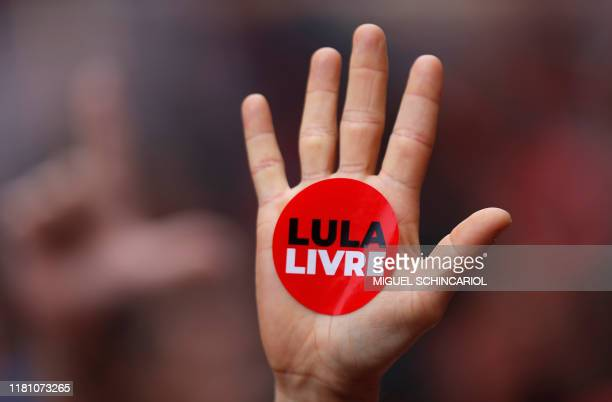 A supporter of former president Luiz Inacio Lula da Silva displays a sticker reading Lula Free on his hand during a gathering outside the...