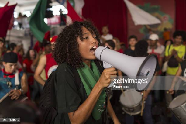Supporter of former President Luiz Inacio Lula da Silva shouts slogans during a protest against Lula's arrest warrant outside the metal workers'...