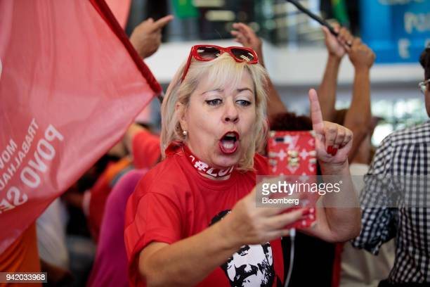 Supporter of former PresidentLuiz Inacio Lula da Silva reacts while watching the Supreme Court's sentence ruling at the Metal Worker's Union in Sao...