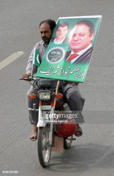 A supporter of former Prime Minister of Pakistan Nawaz Sharif attends a rally to show solidarity during his departure from Islamabad to Lahore on...