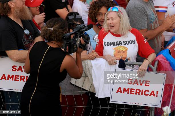"""Supporter of former U.S. President Donald Trump is interviewed by a journalists during a """"Save America"""" rally at York Family Farms on August 21, 2021..."""