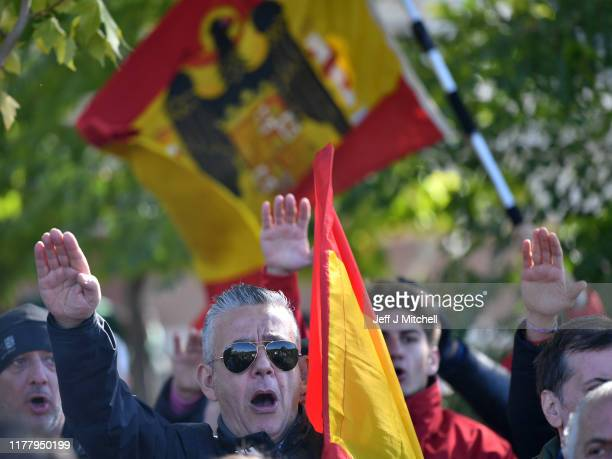A supporter of Francisco Franco gestures as people gather near Mingorrubio cemetery before his exhumation on October 24 2019 in El Pardo neighborhood...