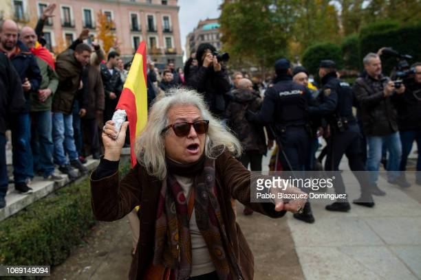 A supporter of Franco shouts at FEMEN activists after they protested against fascism during a rally commemorating the 43rd anniversary of Spain's...