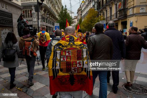 A supporter of Franco wears the preconstitutional Spanish flag during a rally commemorating the 43rd anniversary of Spain's former dictator General...
