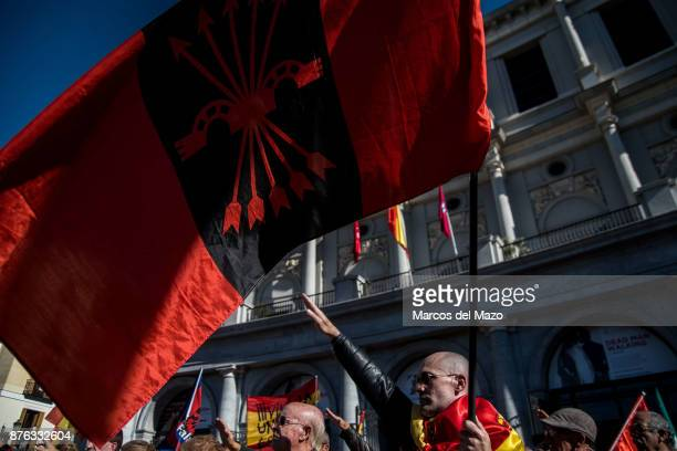 A supporter of Franco with a fascist flag making a nazi salute during a rally commemorating the 42nd anniversary of dictator Francisco Franco's death