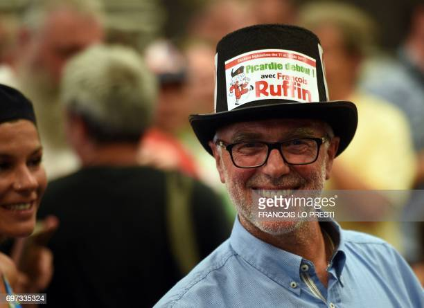 A supporter of French film director and journalist candidate for La France Insoumise for the legislative elections Francois Ruffin in Flixecourt...