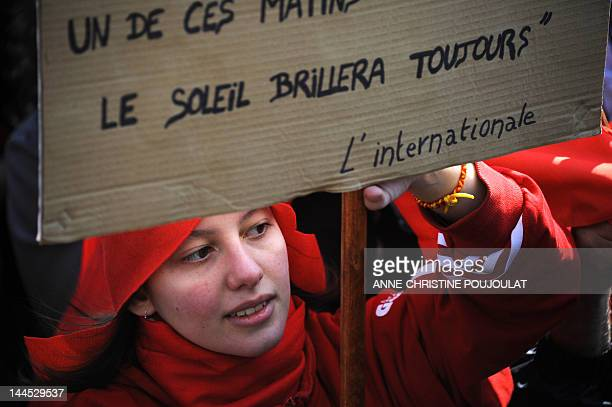 Supporter of French Front de Gauche leftist party's candidate for the 2012 French presidential election holds a banner during a campaign meeting on...