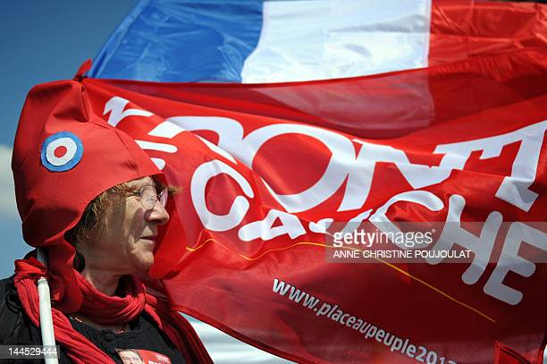 A supporter of French Front de Gauche leftist party's presidential candidate takes part in a campaign meeting on April 14 2012 at the Plage du Prado...