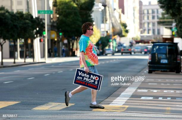A supporter of gay marriage holds a sign as he walks to a rally against the passing of Prop 8 on November 15 2008 in San Francisco California People...