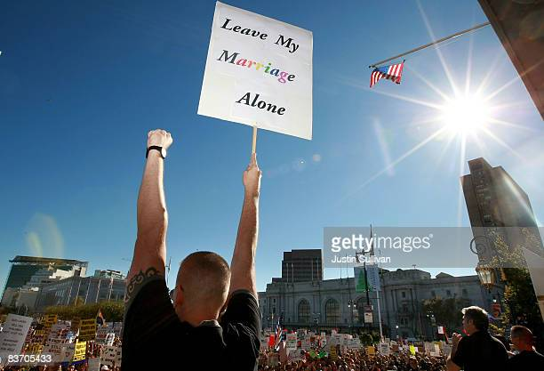 A supporter of gay marriage holds a sign saying 'Leave My Marriage Alone' during a rally against the passing of Prop 8 on November 15 2008 in San...