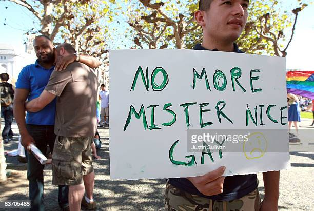 A supporter of gay marriage holds a sign saying 'No More Mister Nice Gay' during a rally against the passing of Prop 8 on November 15 2008 in San...