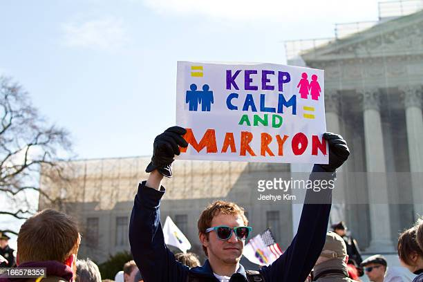 Supporter of gay marriage holds sign during the DOMA and Prop 8 hearing at the Supreme Court in March 2013.