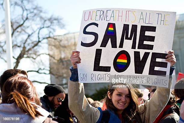 Supporter of gay marriage holds signs during the DOMA and Prop 8 hearing at the Supreme Court in March 2013.