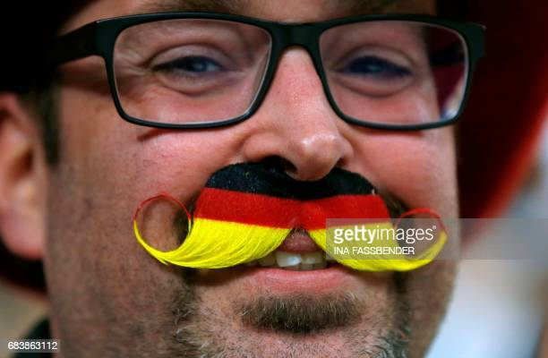A supporter of Germany smiles during the IIHF Men's World Championship Ice Hockey match between Germany and Latvia in Cologne western Germany on May...