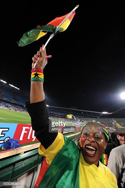 A supporter of Ghana waves a Ghanaian flag in the stands during the Group D first round 2010 World Cup football match Serbia vs Ghana on June 13 2010...