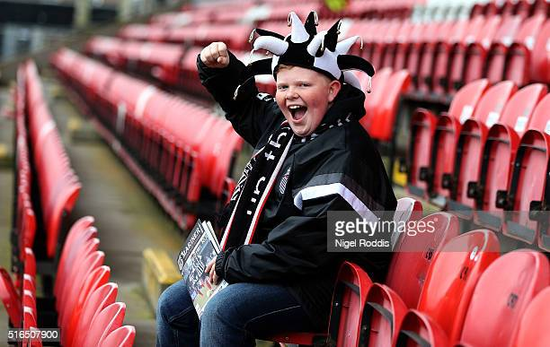 A supporter of Grimsby Town reacts ahead of the FA Trophy Semi Final Second Leg between Grimsby Town and Bognor Regis at Blundell Park on March 19...