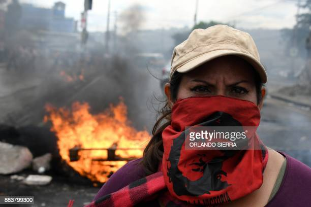 TOPSHOT A supporter of Honduran presidential candidate for the Opposition Alliance against the Dictatorship coalition Salvador Nasralla stands at a...