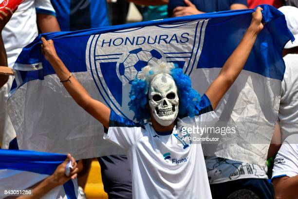 A supporter of Honduras waits for the start of the 2018 World Cup football qualifier match between Honduras and the United States in San Pedro Sula...