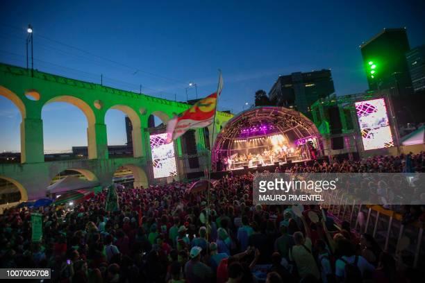 A supporter of imprisoned former Brazilian President Luiz Inacio Lula da Silva attend the Lula Livre Music Festival in Rio de Janeiro Brazil on July...