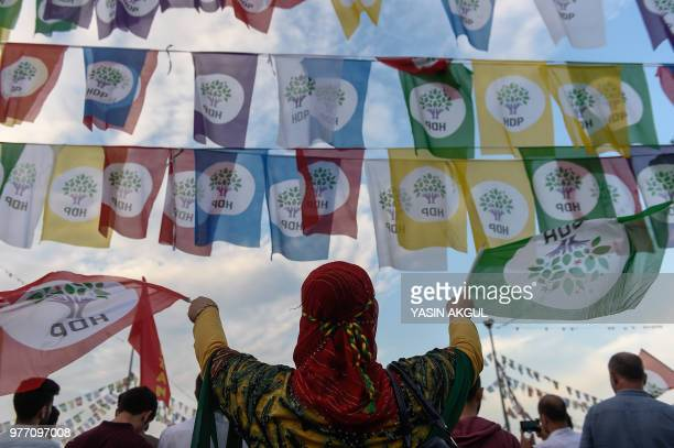 Supporter of imprisoned Selahattin Demirtas, presidential candidate of the pro-Kurdish People's Democratic Party , waves party flags during a...