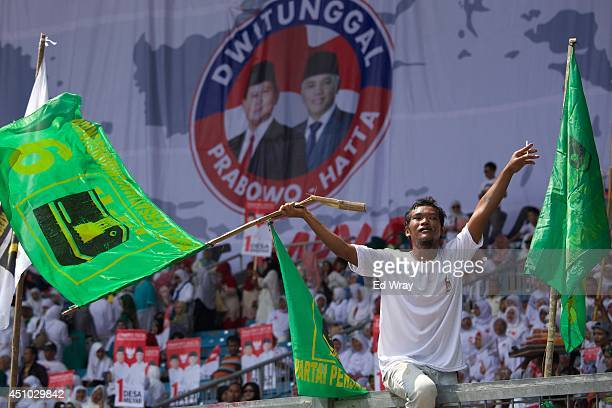 A supporter of Indonesian Presidential candidate Gen Prabowo Subianto Leader of the Gerindra Party waves a flag during an election rally at Gelora...