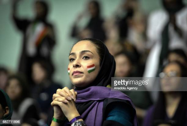 A supporter of Iranian Presidential candidate Hassan Rouhani participates the meeting at Azadi Sport Complex ahead of the presidential elections that...