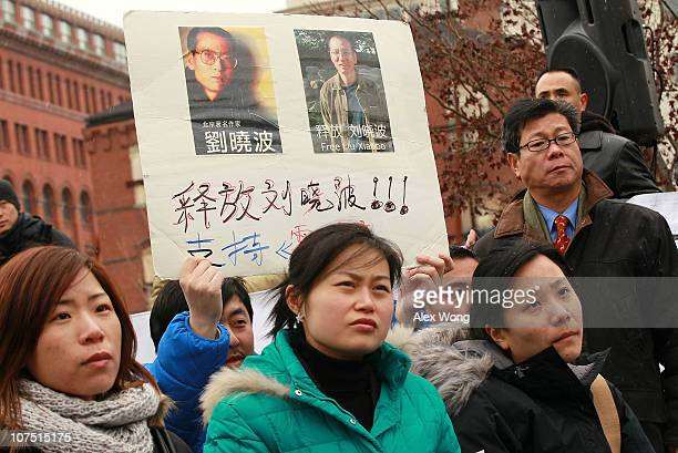 A supporter of jailed Chinese dissident and Nobel Prize laureate Liu Xiaobo holds a sign calling on his release durinng a rally for Liu December 10...