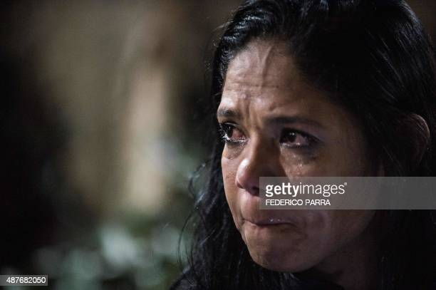 A supporter of jailed opposition leader Leopoldo Lopez reacts after learning of his guilty verdict in Caracas on September 10 2015 Jailed Venezuelan...