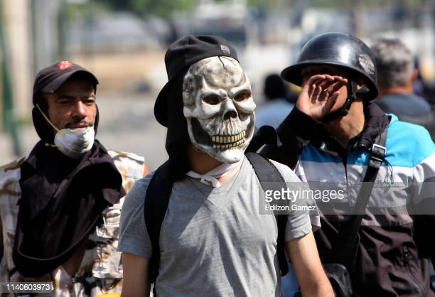 A supporter of Juan Guaido wears a mask during the May 1 demonstrations at avenida Francisco de Miranda on May 1 2019 in Caracas Venezuela Yesterday...