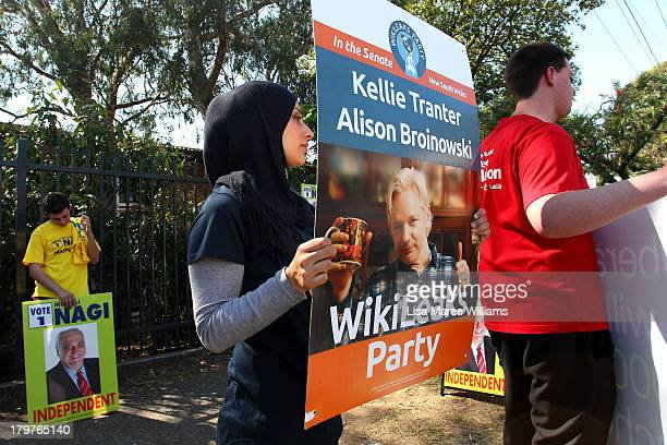 A supporter of Julian Assange and his Wikileaks party campaigns in the electorate of Barton on election day on September 7 2013 in Sydney Australia...