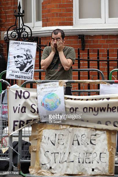 Supporter of Julian Assange, founder of the WikiLeaks whistle-blowing website, rubs his face as he waits outside the Ecuadorian Embassy where Mr...