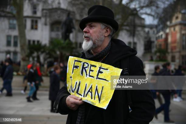 A supporter of Julian Assange stands in Parliament Square on February 22 2020 in London England Protestors against the UK government's intention to...