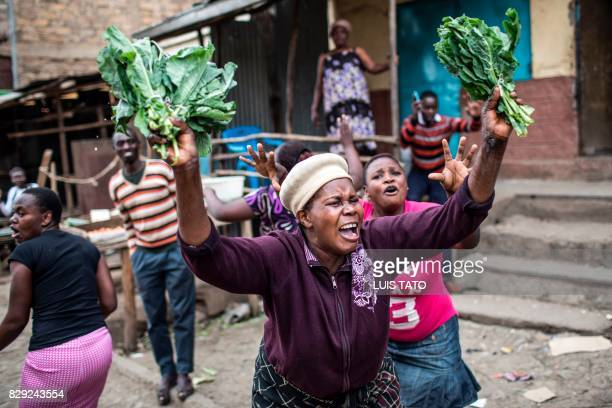 Supporter of Kenyan opposition presidential candidate Raila Odinga reacts during a march on August 10, 2017 in the Mathare slum in Nairobi, following...