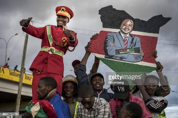 A supporter of Kenya's president Uhuru Kenyatta salutes from the crowd in Nairobi Kenya on Monday Oct 23 2017 Kenya's president Uhuru Kenyatta met...