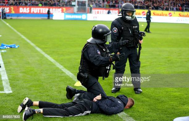 A supporter of Kiel is atrrested by the police before the Second Bundesliga match between Holstein Kiel and FC St Pauli at HolsteinStadion on...