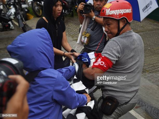 A supporter of late Philippine dictator Ferdinand Marcos attempts to grab a banner from an antiMarcos protester during a tussle at a demonstration...