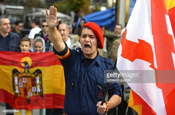 A supporter of late Spanish dictator General Francisco Franco performs the fascist salute and shouts slogans as he attends the 39th anniversary of...