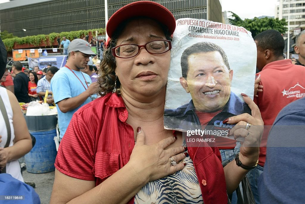 A supporter of late Venezuelan President Hugo Chavez reacts during the commemoration of the first anniversary of his last presidential campaign in Caracas on September 4, 2013. AFP PHOTO/Leo RAMIREZ