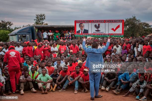 TOPSHOT A supporter of Lazarus Chakwera leader of the Malawi Congress Party the main Malawi opposition party holds a sign during a campaign rally at...