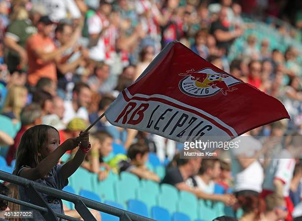 A supporter of Leipzig with a flag is pictured during the B Juniors Bundesliga final match between RB Leipzig and Borussia Dortmund at Red Bull Arena...
