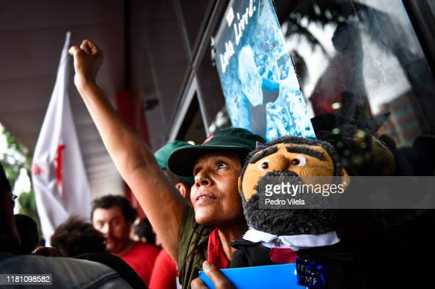A supporter of Luiz Inacio Lula da Silva Brazil's former president holds a figure with his likeness at the Sindicato dos Metalurgicos do ABC on...