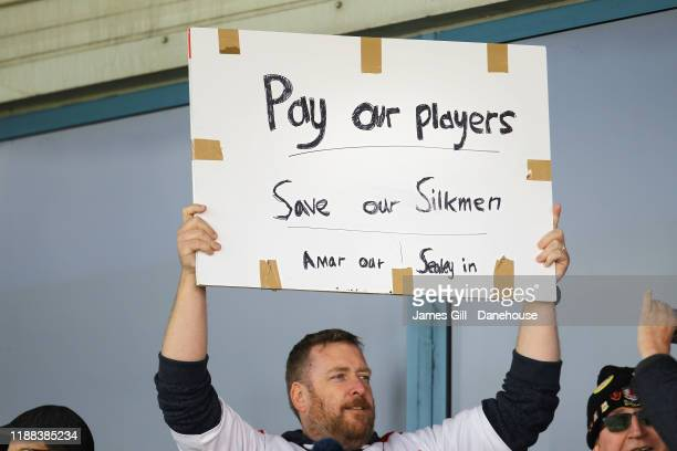 Supporter of Macclesfield Town shows a protest sign during the FA Cup First Round match between Macclesfield Town and Kingstonian at Moss Rose Ground...