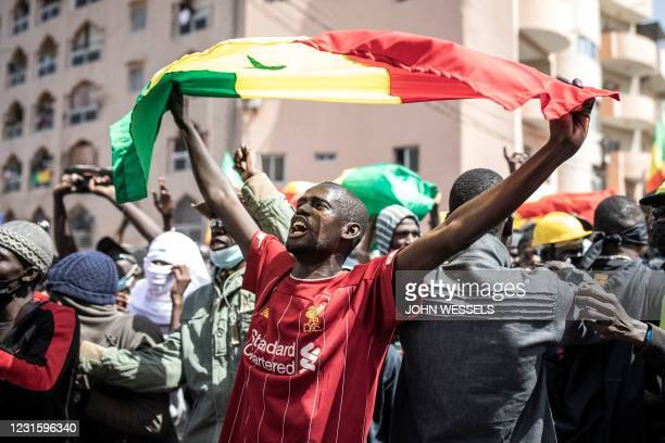 Supporter of main opposition candidate, Ousmane Sonko, reacts in protest outside the Justice Palace in Dakar on March 8, 2021. - Protests have been...