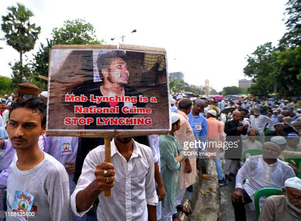A supporter of MajliseUlamaeIslam West Bengal holds a placard during the Protest in Kolkata Protest against the recent Mob lynching incidents at...