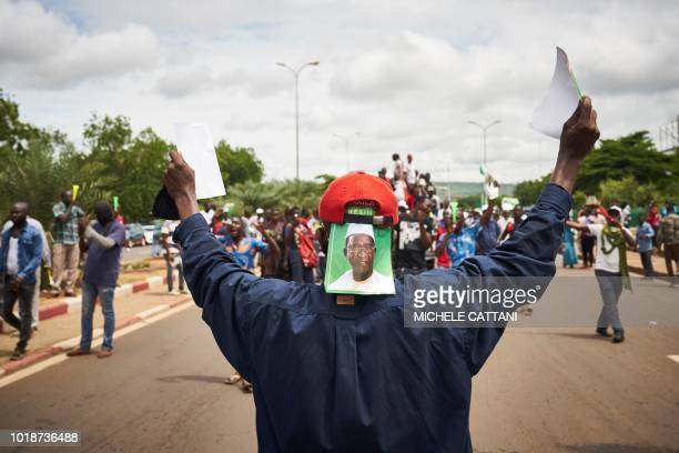 TOPSHOT A supporter of Malian opposition leader Soumaila Cisse gestures as he takes part in a rally to contest the results of presidential runoff...