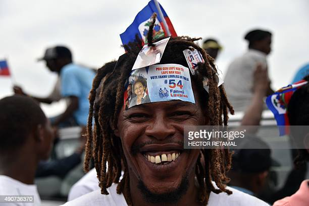 A supporter of Maryce Narcisse a presidential candidate from the Lavalas Political party smiles during a party rally in PortauPrince on September 30...
