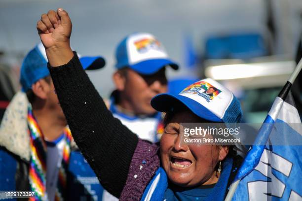 Supporter of MAS candidate Luis Arce shouts slogans during a celebration the day after general elections on October 19, 2020 in El Alto, Bolivia....