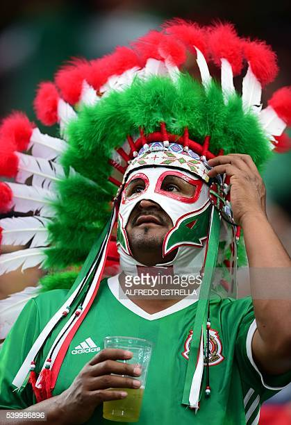 A supporter of Mexico waits for the start of the Copa America Centenario football tournament match against Venezuela in Houston Texas United States...