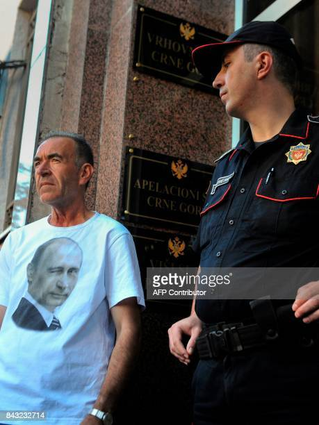 A supporter of Montenegro opposition Democratic Front leaders Andrija Mandic and Milan Knezevic wearing a tshirt with a picture of Russian President...